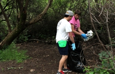 Connor Sobon (right), a freshman psychology and marketing double major, and Nate Mash (left),a freshman history major, scout out trash in Lower Bidwell Park.