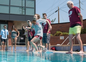 Associated Students President Taylor Herren (left) takes the first leap as Chico State President Paul Zingg (right) along with students took the plunge into the pool at the Wildcat Recreation Center (WREC) as part of the Wildcat Way version of the ALS Ice Bucket Challenge event Monday, September 1, 2014 in Chico, Calif.