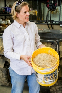 Jamie Visinoni, the reserve's manager, explains that the staff collects and spreads native grass seeds.